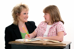 Teacher and girl : © Photographer: Jaimie Duplass | Agency: Dreamstime.com